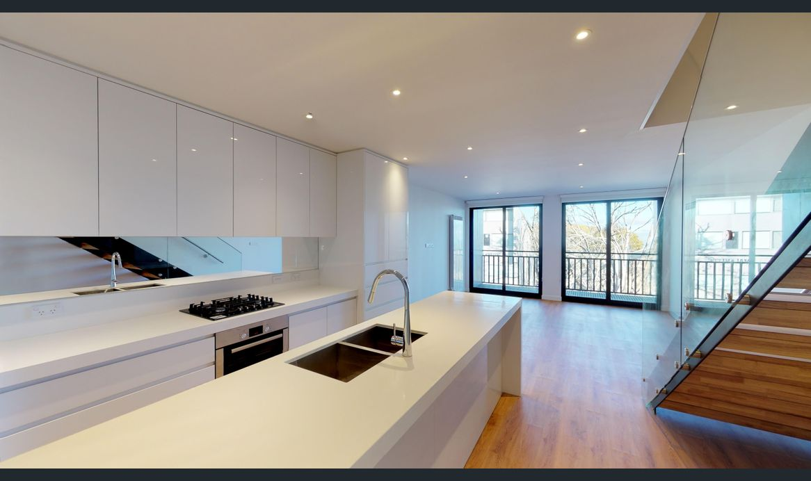 Kitchen cabinets in high gloss white lacquer finish